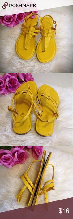 Sunny yellow sandals sz 6.5 Perfect for the sun outside! Used only once  *sz 6.5 *brand is Sunny feet  *open toe *thong style  *strap to close with adjustable sizing *padded insoles  *prefect for the beach and anything outdoors  *bright mustard yellow color sunny feet Shoes Sandals