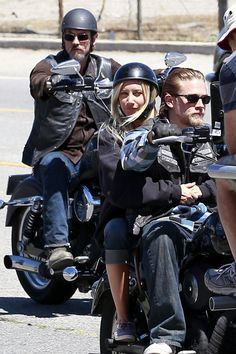 Ashley Tisdale Charlie Hunnam Photos - Ashley Tisdale dons a crash helmet as she continues to film her 'Sons of Anarchy' guest spot in Los Angeles. The former 'High School Musical' star can be seen getting a few pointers from her co-star Charlie Hunnam before joining him on the back of the motorcycle. - Ashley Tisdale holds onto Charlie Hunnam as they motor around the set of 'Sons of Anarchy' in LA