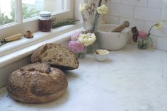 i love this photo from 101cookbooks.com. The smattering of flowers, and sesame seeds from a most perfect loaf of bread...lovely