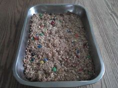 home made granola bars - oats and Rice Krispies. M & M GRANOLA BARS  2 cups quick cooking oats  1 cup Rice Krispies  Half cup brown sugar  Half cup honey  Three-fourths cup peanut butter  Three-fourths cup M & Ms  Preheat oven to 350.  Mix all ingredients in a large bowl. Press into a greased 9 X 13 inch pan and bake 18 minutes. Cool and then cut into squares or rectangles.