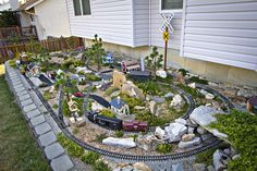 Mark Hann of O'Fallon, Missouri who is a Cuivre River Electric Cooperative, does garden railroading in his backyard. Garden Railings, Garden Gates, Garden Train, Train Ho, Garden Railroad, Hobby Lobby Christmas, Love Garden, Model Train Layouts, Train Tracks