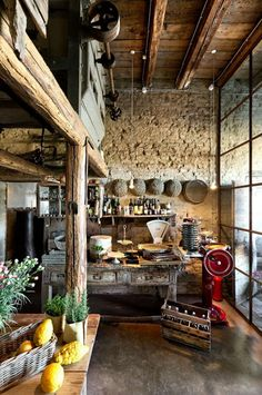 Rustic kitchen. I love the stonework and vintage pottery in here!