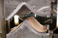 The 3107 Chair - A hydraulic press molds the stacks into chair forms