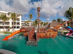 This luxury resort in Riviera Maya is all-inclusive, complete with a dedicated Family Concierge who can deliver baby and children's gear to your room as well as arrange activities such as vacation scrapbook making, beginner scuba diving classes, camping trips, and arts and crafts. At the end of the vacation day, it's really all about the pool and Paradisus' dedicated family pool does not disappoint; it features a pirate ship with multiple slides.