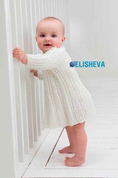 Платье для девочки с ажурными дорожками: описание вязания спицами и схема