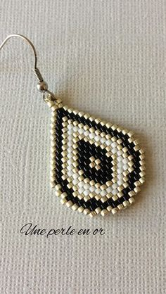 black, white and silver drop shaped earrings. - black, white and silver drop shaped earrings. done by myself taking care of quality and detail. Beaded Earrings Patterns, Jewelry Patterns, Diy Earrings, Earrings Handmade, Handmade Jewelry, Seed Bead Jewelry, Seed Bead Earrings, Beaded Jewelry, Diy Accessories