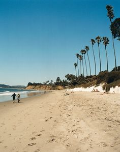 Butterfly Beach in Santa Barbara, California - a getaway dotted with Mediterranean mansions, wine trails, and open-air trolleys.