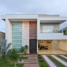 Fachada: Casas Minimalista por Livia Martins Arquitetura e Interiores