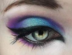 Turquoise and purple eye shadow.