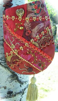 I ❤ crazy quilting & embroidery . . .  lovely heart themed pouch.