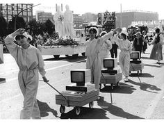 Workers of VEB Kombinat Robotron demonstrate personal computers as technological achievements in a parade in East Germany, 1987