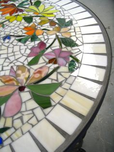 ABOUT THIS ITEM: This is listing for a 30 MADE TO ORDER mosaic table top executed in a flowing FLORAL motif. This is a custom, hand made, one of a kind, work of function art that can be customized to your liking. The images shown are merely examples of the floral compositions I am able to create on these table tops. You are invited to join the creative process as I create something specifically for your home or garden.  My table tops are created on cement fiber board set within an inlaid rim…