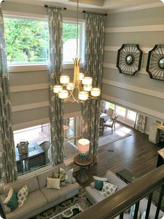 Love how the upstairs over looks the downstairs, and the long drapes really bring everything together!