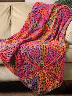 If you've ever seen the glorious colors of a Colorado sunset reflected in Red Rock Canyon, you'll see a similar palette in the vibrant hues of this beautiful throw created in large triangular motifs. This e-pattern was most recently published in the Crochet World special publication Blue Ribbon Crochet.