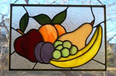 Beautiful panel with different types of fruit as the subject. The fruit in this panel is made of glass that has different colors and textures.