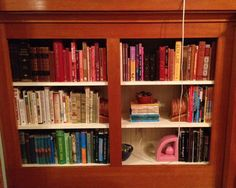 Arranging books by color.