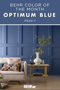 Is there anything better than a decorative paneled wall? How about one that has been painted with the Behr paint Color of the Month: Optimum Blue? This medium-tone blue fits seamlessly into the traditional design of this living room. Click below to see more.
