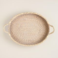 Crafted of light-colored rattan and edged with rope, our rustic woven tray is ideal for serving drinks or creating a display on your buffet or home bar.