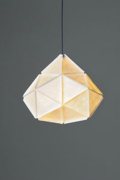 Joa Herrenknecht's abstract lighting sculptures, called KOGI, are constructed out of pieces of lightweight Tyvek that are cut into triangles and assembled into their hanging forms.