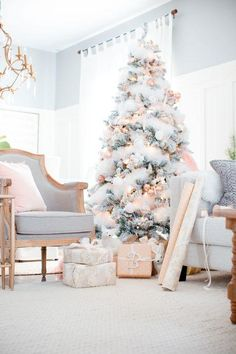 These pink Christmas trees have us ready for a pink Christmas. Find inspiration with these decorating ideas to deck out your own pink Christmas tree. Noel Christmas, Christmas And New Year, Winter Christmas, Simple Christmas, Rustic Christmas, Vintage Christmas, Christmas Tree Flowers, Rose Gold Christmas Tree, Christmas Mantles