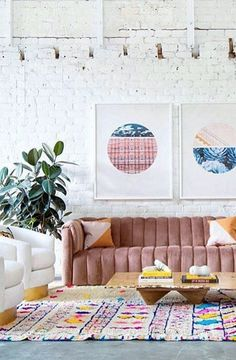 EVERYTHING. Pink couch, Moroccan rug, graphic prints, brick, bright, modern furniture.