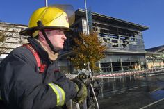 """1 November 2006. Belfast (Northern Ireland): A fireman looks at the shopping center in East Belfast recently bombed by unknown men the night before. """"The Troubles"""" was a period of social and political conflict in Northern Ireland. The duration of """"the Troubles"""" is conventionally dated from the late 1960s and considered by many to have ended with the Belfast """"Good Friday"""" Agreement of 1998. Photo by Albert Gonzalez Farran / www.albertgonzalez.net"""