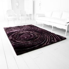 Set your sights on this gorgeous bulls-eye patterned rug to add a touch of modern luxury to any space. Made in India, this hand-tufted rug provides durability and comfort. Also available in teal blue, the Girare offers vibrance on target for brightening your mood and your living space. Polyester Hand Tufted Construction Luxor Purple Dimensions: 5'w x 7.6'lProduct of India
