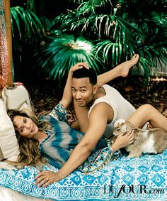 From intimacy to Instagram, celeb couple John Legend and Chrissy Teigen sat down with DuJour to chat about what their lives are like. Read the full interview.   ON TEIGEN: Poncho, $16,789, Etro. On nails: Nail lacquer in Nude Lilac, $26, Dolce & Gabbana. On eyes: Duo eyeshadow in St-Paul-De-Vence, $35, NARS,   On LEGEND: Tank, $950, GUCCI.  Goats provided by Little Critters.