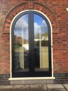 Enhance the beauty and security of your property with our beautiful interior and exterior doors. Our doors are reliable, durable and built to last. Speak to our friendly team at Trustwood Joinery Manufacturers Ltd in Leicester today. Arched Front Door, Front Door Porch, Porch Doors, Double Front Doors, Arched Doors, House Front Door, House With Porch, Arched Windows, Windows And Doors