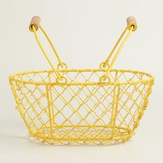 One of my favorite discoveries at WorldMarket.com: Small Yellow Wire Easter Baskets Set of 2