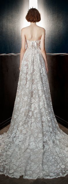 The Georgia. A princess ballgown with a sheer corset top embroidered with 3-D flowers and a voluminous pleated skirt with layers of Blush and Ivory silk tulle and flocked tulle with a Victorian Rose pattern made of pearl caviar sequins with Silver accents. #wedding #dress #couture #bride
