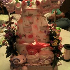 Baby girl shower gift featuring cute dress on a cloths line with everything needed to do laundry. Plus some cute onesie/receiving blanket cupcakes