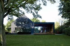 WillemsenU Architecten has remodelled a house near Eindhoven, adding a new dark cladding to the exterior and reorganising the rooms inside Eindhoven, Black Cladding, Timber Cladding, 1960s House Renovation, Contemporary Architecture, Architecture Design, Contemporary Houses, Modern Barn House, Design Exterior