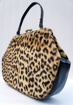 1960 Leopard Handbag by joevintage on Etsy. Leopard prints were the rage on coat collars and covered buttons as well in the 1960s