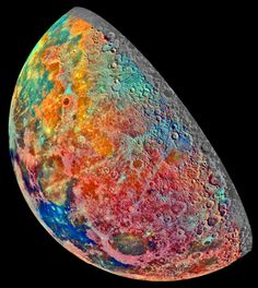 """The Moon on December 7, 1992, in a false-color mosaic built from 53 images taken through spectral filters by Galileo's imaging system as the space probe flew over the northern lunar regions: """"Bright pinkish areas are highlands materials;Blue to orange shades indicate volcanic lava flows. To the left of Crisium, the dark blue Mare Tranquillitatis is richer in titanium than the green and orange maria above it."""