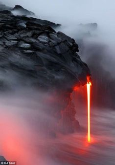 The intrepid duo had to enter the water within feet of where the lava was running into the surf, braving the scalding water and dodging ¿lav...