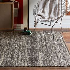 Neutral idea. Over budget, but you do get an extra 10% off if you sign-up for emails. Sweater Wool Rug - Charcoal #westelm