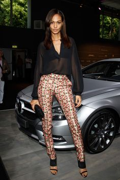 Supermodel, Joan Smalls attended the Rena Lange Show at Mercedes-Benz Fashion Week Spring/Summer 2013, today in Berlin, Germany. The Estee Lauder spokes-model looked stunning in a sheer black blouse, printed pants, and black band strap wedges.