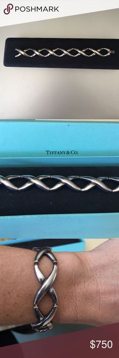 Tiffany & Co Bracelet Beautiful Tiffany bracelet.   Getting rid of it because my ex husband bought it for me and I don't want it any more. Tiffany & Co. Jewelry Bracelets