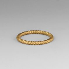 """Simple, feminine and full of subtle texture, this Reinstein/Ross """"Twist"""" band is completely versatile. Handcrafted from their signature 22K apricot gold, this is a ring that holds great value as a wedding band and would also look amazing worn solo or within a greater stack. Let your imagination go! @QUADRUM"""