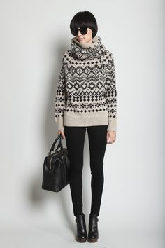 Wool intarsia sweater with cowl neckline. Long raglan sleeves with dropped armhole. Ribbed trim at neck, cuffs and hem. Slips on. Yohji Yamamoto $1008 Totokaelo