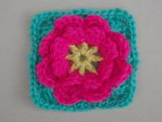 Flower Granny Square Crochet Tutorial - Flower can be made separately ~ turn the squares into a pillow..very pretty ~ free pattern