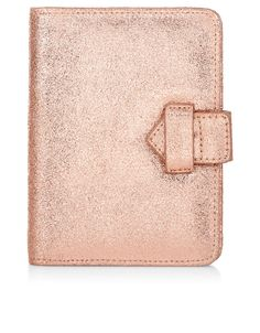 Jet off in style with our leather passport holder, designed with slip pockets and a strap fastening.