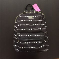CLOSET CLEAROUT❗️Betsey Johnson Backpack (was $62) Signature banner black fabric and black leather-like bottom.  Black top handle and where shoulder straps attach.  Front zipper pocket, 2 open side pockets.  Gold hardware.  Additional flat pocket on back and inside slots for flat items/cards. Betsey Johnson Bags Backpacks