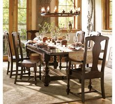 Love the strong look of this dining set, it has a very Spanish Hacienda look to me. And I like that there are no fabric seats (so much easier to clean!).