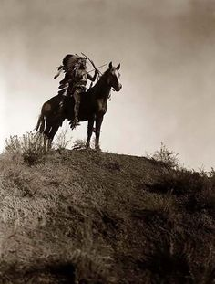 "You are viewing an impressive photograph called ""Ready For Charge"". It was taken in 1908 by Edward S. Curtis.  The picture shows an Indian in feather headdress, on horseback, holding a bow and arrows. He has one arrow in his mouth, prepared for a quick reload. This is a fascinating view of an authentic Indian Warrior."