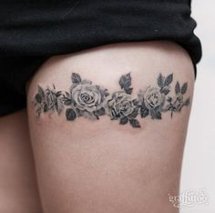 Blackwork floral band on thigh by Tattooist River