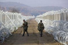 """Soldiers on Macedonia border.  Nato has accused President Putin of weaponising the migrant crisis in an effort to push Europe to the brink of collapse. As Britain was told to pay £63 million to help Greece to cope with soaring numbers of trapped incomers, Russia and Syria were blamed for intensifying the tension between allies. """"Together, Russia and the Assad regime are deliberately weaponising migration in an attempt to overwhelm European structures and break European resolve,"""""""