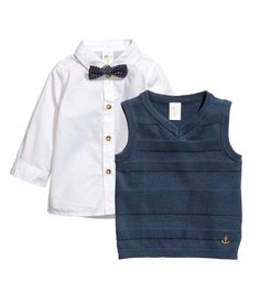 Check this out! Set with a shirt and sweater vest in cotton fabric. Shirt with collar, buttons at front and at cuffs, and a detachable bow tie with plastic fastener. Sweater vest in a textured knit with a V-neck. - Visit hm.com to see more.