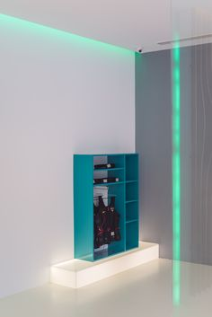 stander from glossy blue MDF on a plexyglass illuminated base orders/price offers at: office